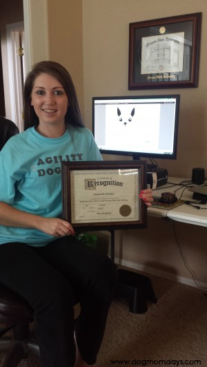 Me with my certificate of recognition for being a finalist in the Best New Pet blog category.