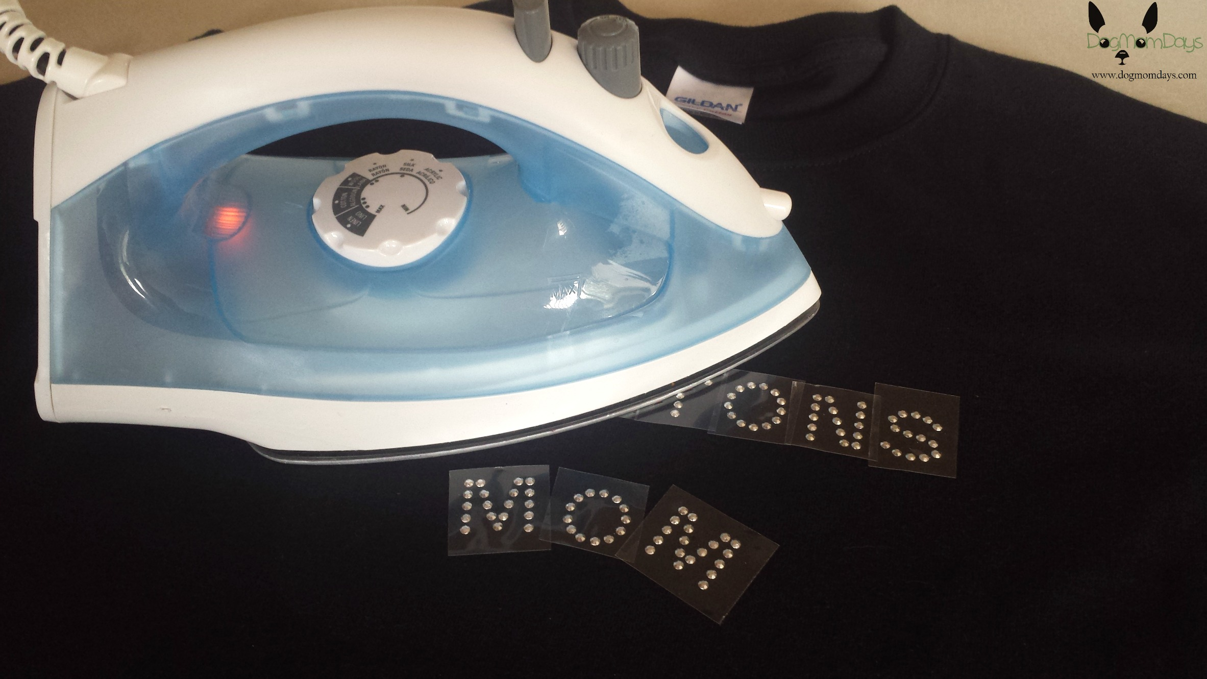 Ironing on the letters.